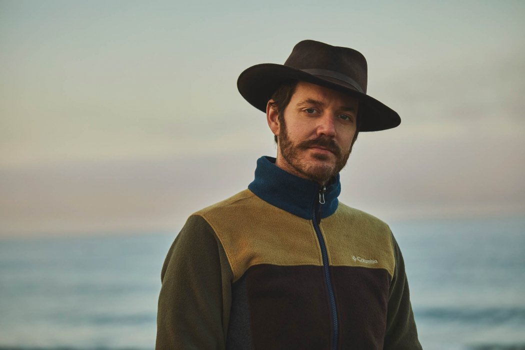 A portrait of a man with hat and Columbia sweater - portrait photography