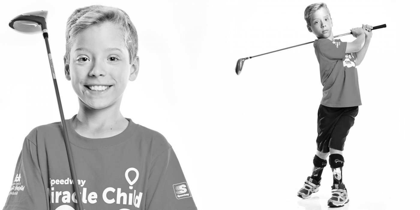 Portrait of charitable kid with golf clubs - portrait photo