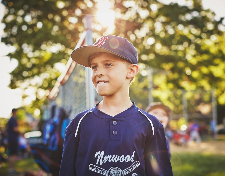 Portrait of a young boy at a base ball game - Sport photography