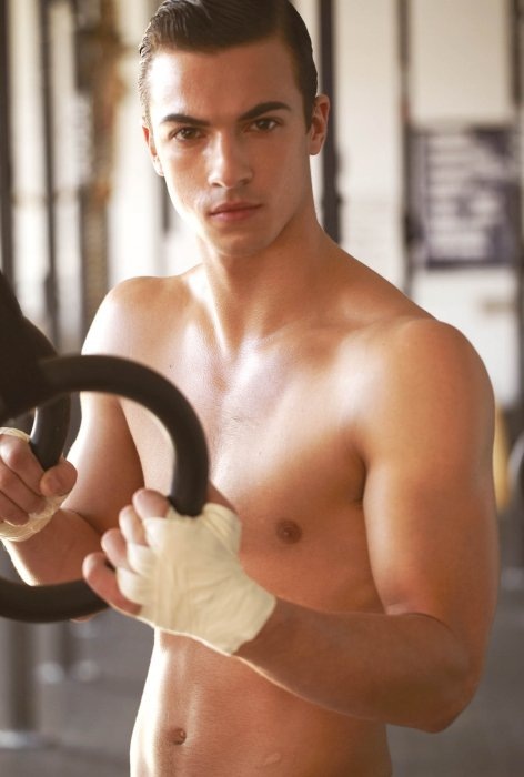 A young man working out at a gym - sport photography