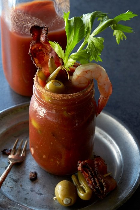 A bloody mary cocktail with olives shrimp and bacon - drink photography