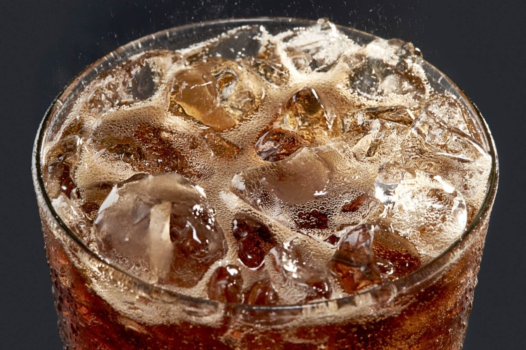 Bubbling cola drink with ice - modern - drink photography