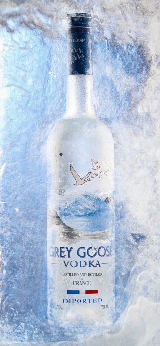 Blue grey goose bottle top surrounded in ice - drink photography