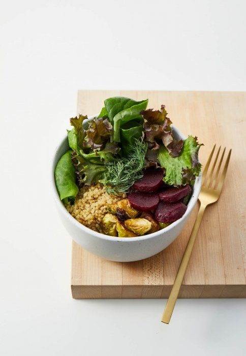 A fresh bow of salad green couscous beets and more - food photogrpahy