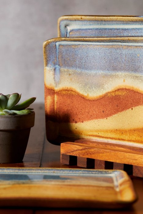 High end pottery ceramic plates and bowls - with red earth tones - product photography