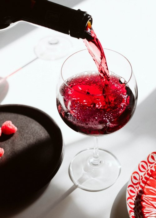 Nero d'avola menfi wine being poured on table with dark lighting - wine photography