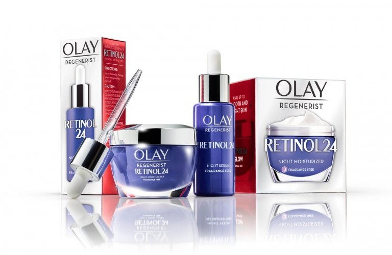 Olay group of products on white - regenerist retinol products - product photography