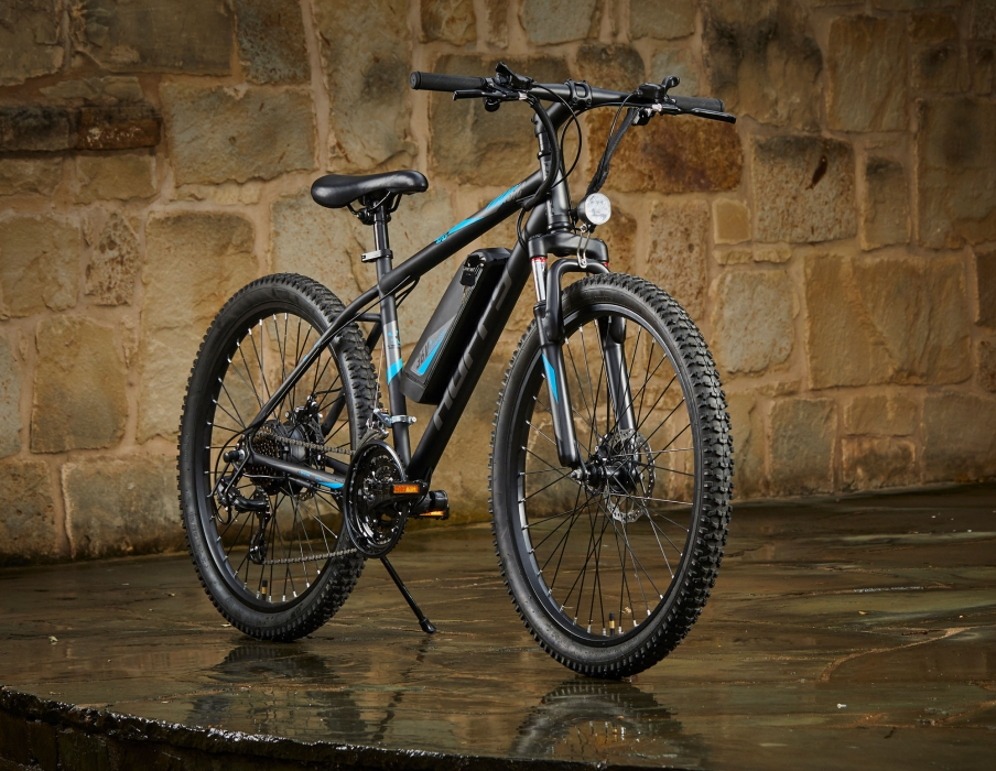 A huffy bike on in a stone covered setting - product photography