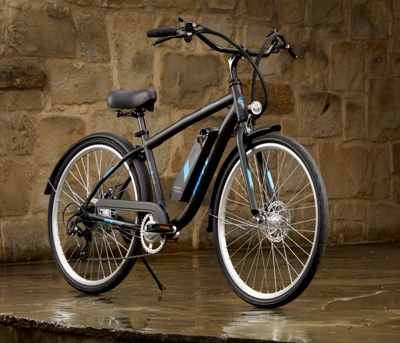 A huffy bike on in a stone covered setting black electronic- product photography