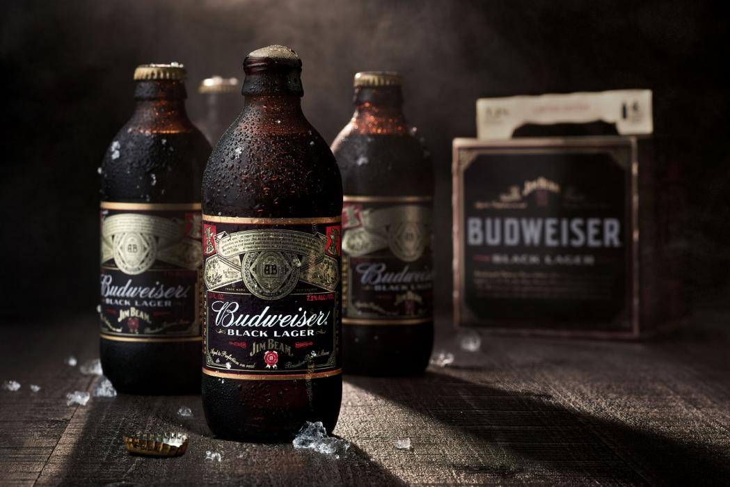 Budweiser black lager beer in dark wood setting- beer photography