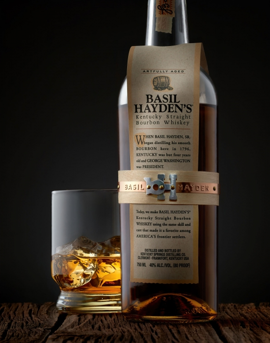 Basil Hayden's Kentucky straight bourbon whiskey bottle and glass served neat - drink photography