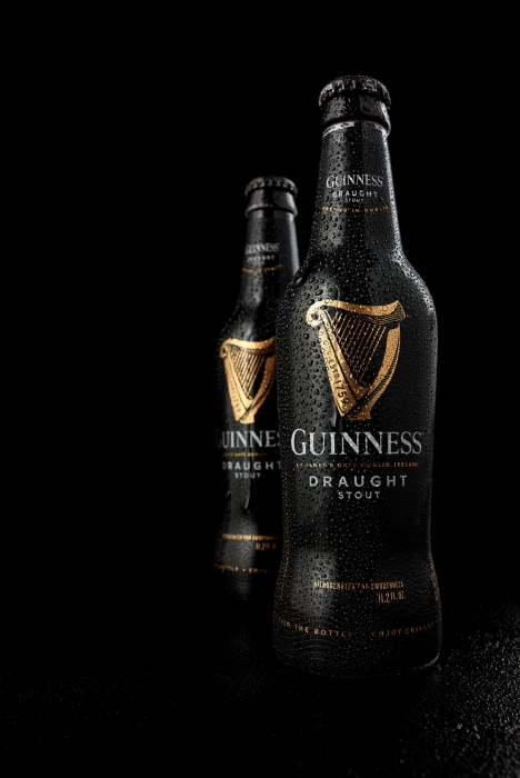Guiess braught stout bottles sweating - dark - beer Drink photography