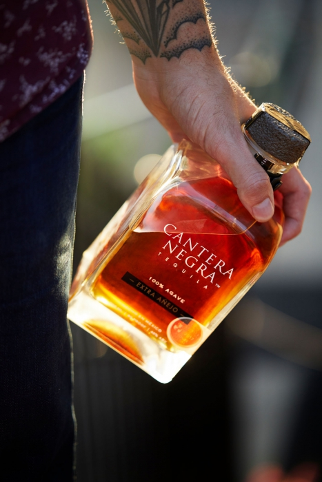 Extra Anejo Tequila being held at a party - Cantera Negra Tequila - Drink Liquor Photography