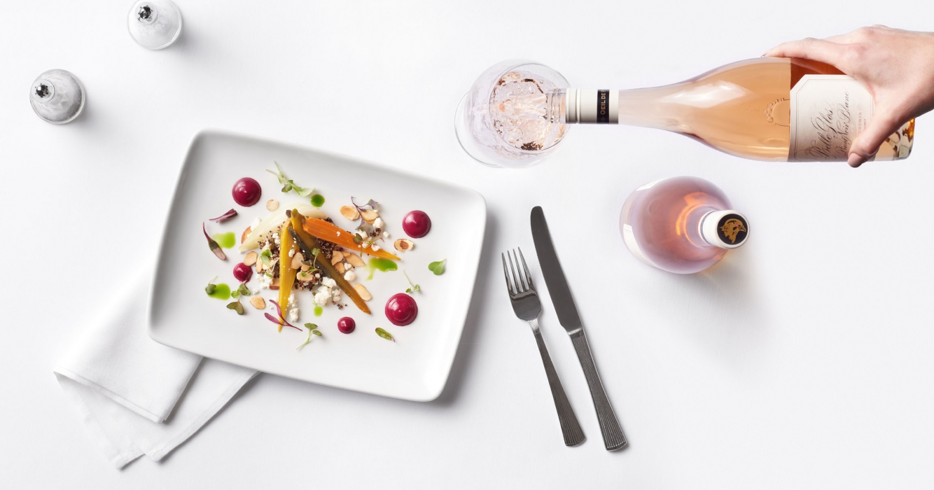 A top down view of nice rose wine and salad - food and drink photography