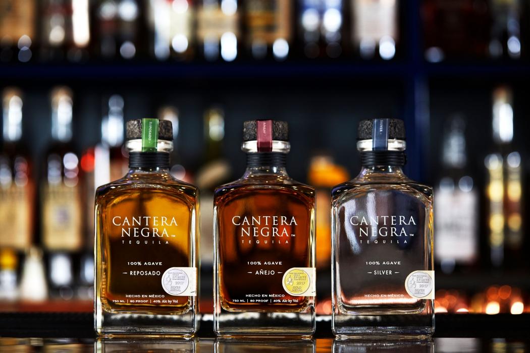 Three Cantera Negra bottles at a bar - drink photography