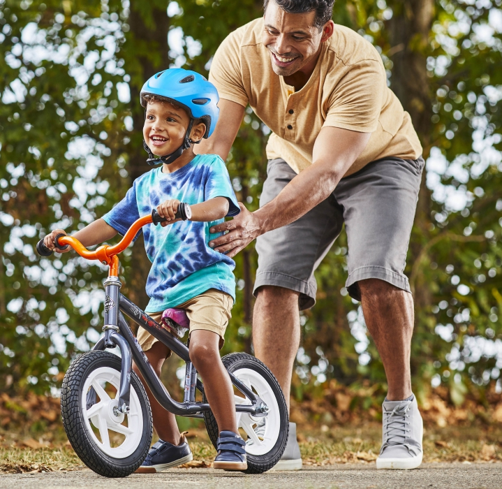 A father and sun having fun with a bike - lifestyle product photography