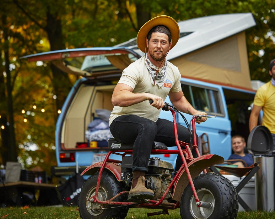 A man riding a small off road bike having a good time - lifestyle photography