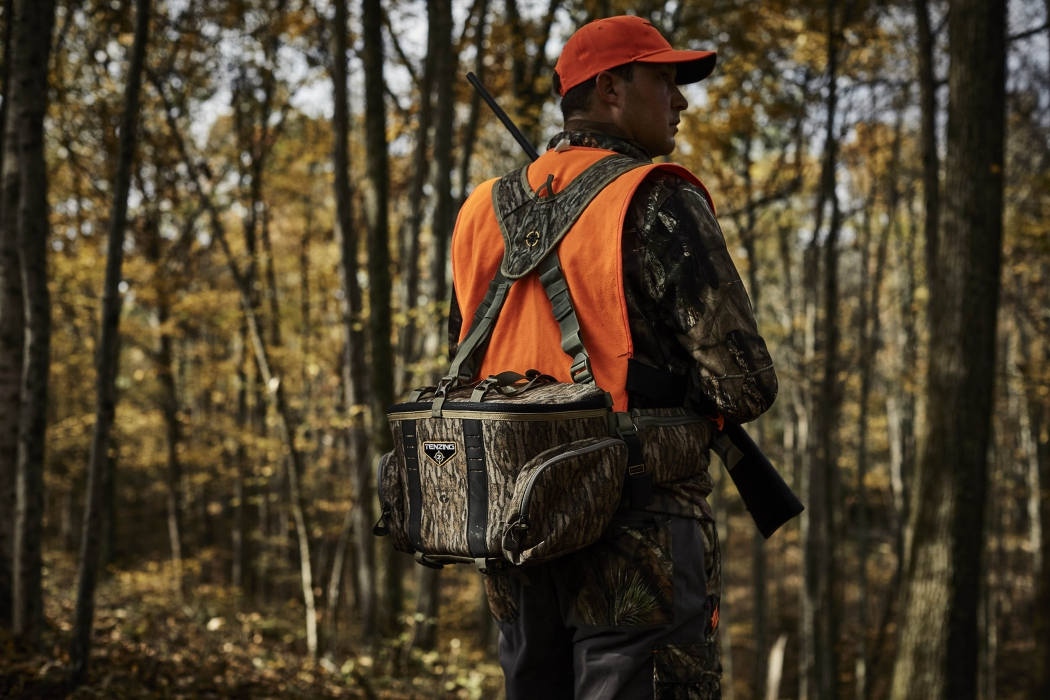 A man carrying a tenzing hunting bag - outdoor product photography