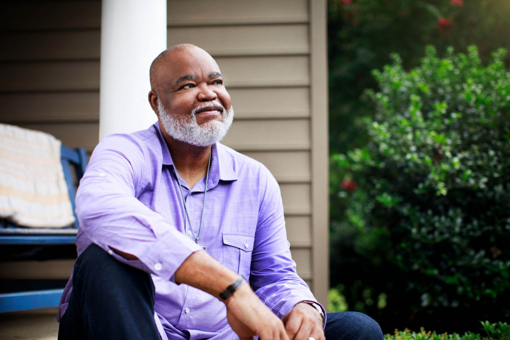 A portrait of a older man on a porch - portrait photography