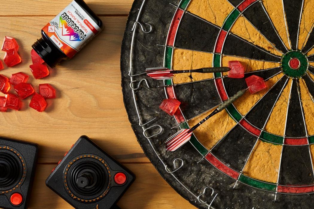 Tastebuds CBD Cannabis Gummies with dart board - CBD and Cannabis Photography
