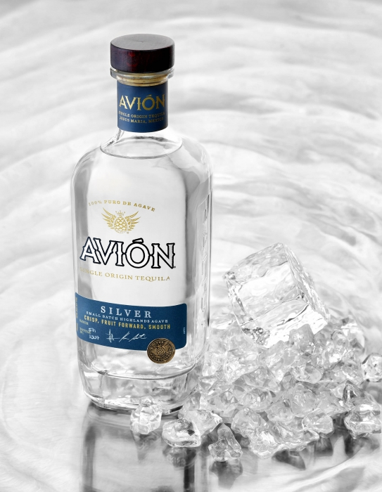 Avion silver tequila a pile of ice and ripples - drink photography