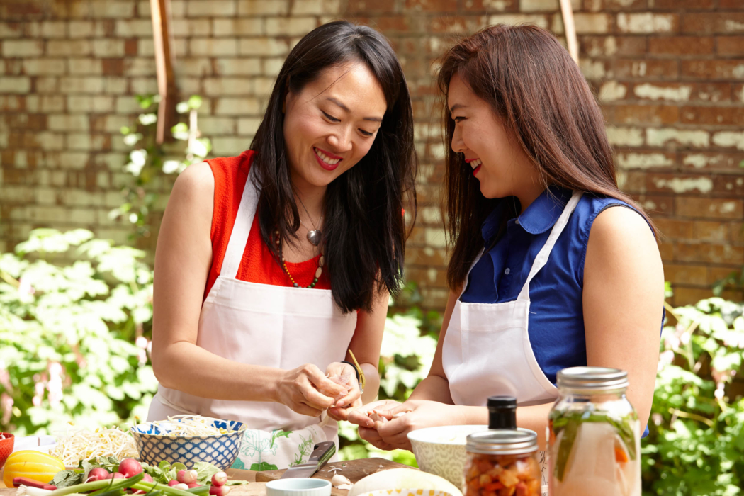 two women enjoying korean BBQ outside in NYC - Food Lifestyle Photography