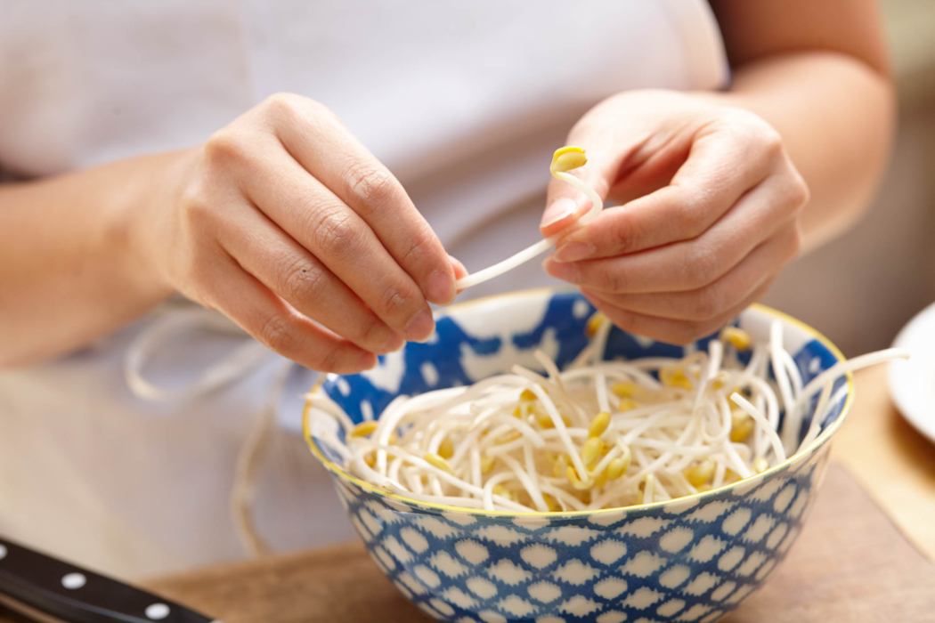 A woman picking bean sprouts - Food Lifestyle Photography