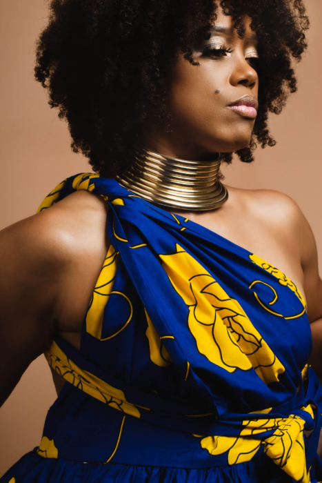 portrait of a powerful woman with a blue dress - modern photography - portrait photographer