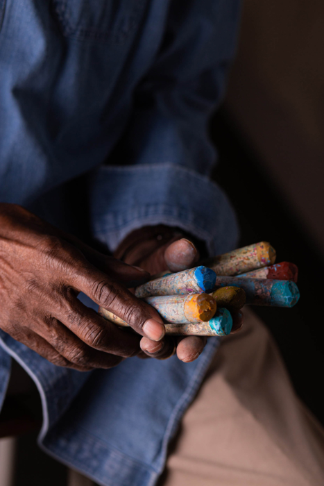 Portrait of an artists hands with colorful pastel Portrait of a man laughing with his hand out - modern photography - portrait photographer
