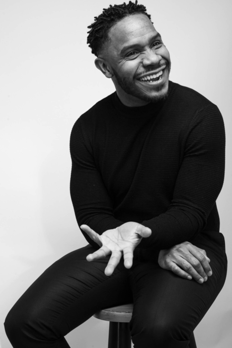 Portrait of a man laughing with his hand out - modern photography - portrait photographer
