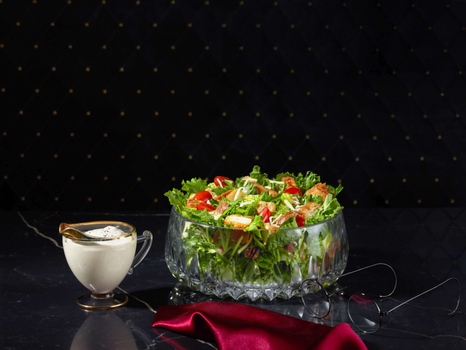 A nice chicken bacon ranch salad with dressing on the side -