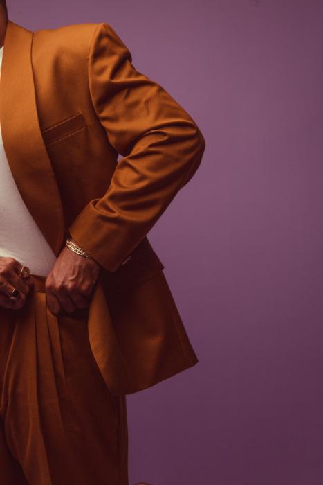 portrait of a man with dark suit on purple background side view - Dayton Portrait Photographer