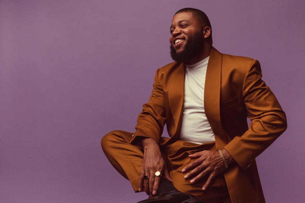 portrait of a man with dark suit on purple background - Dayton Portrait Photographer