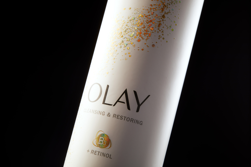 Product photo of OLAY restoring lotion bottle and label - close up view -dark mode photo