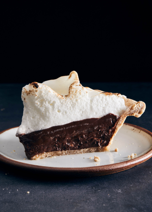 Food photo of chocolate mousse pie slice on a dark background