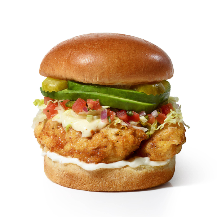 Food photography for restaurant menu of a fried chicken sandwich with avocado and more.
