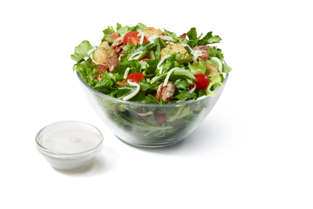 Food photography for restaurant menu of a fried chicken salad with ranch.