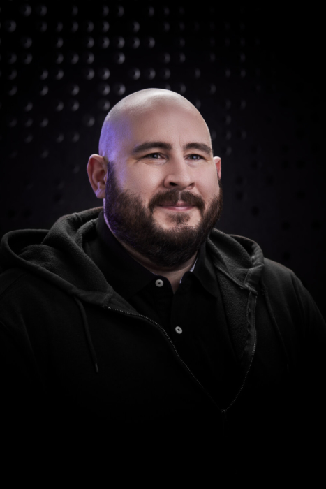 Portrait of a man with a beard on a modern dark background - portrait photography