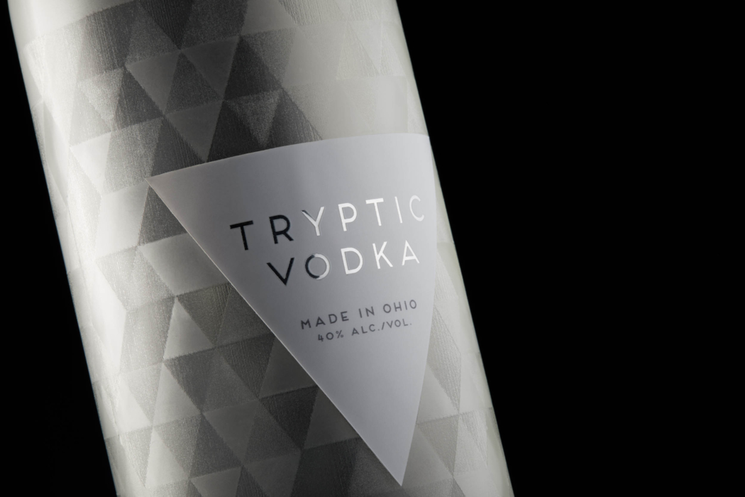 Drink photography of Tryptic Vodka bottle and label - side angle view - dark mode photo