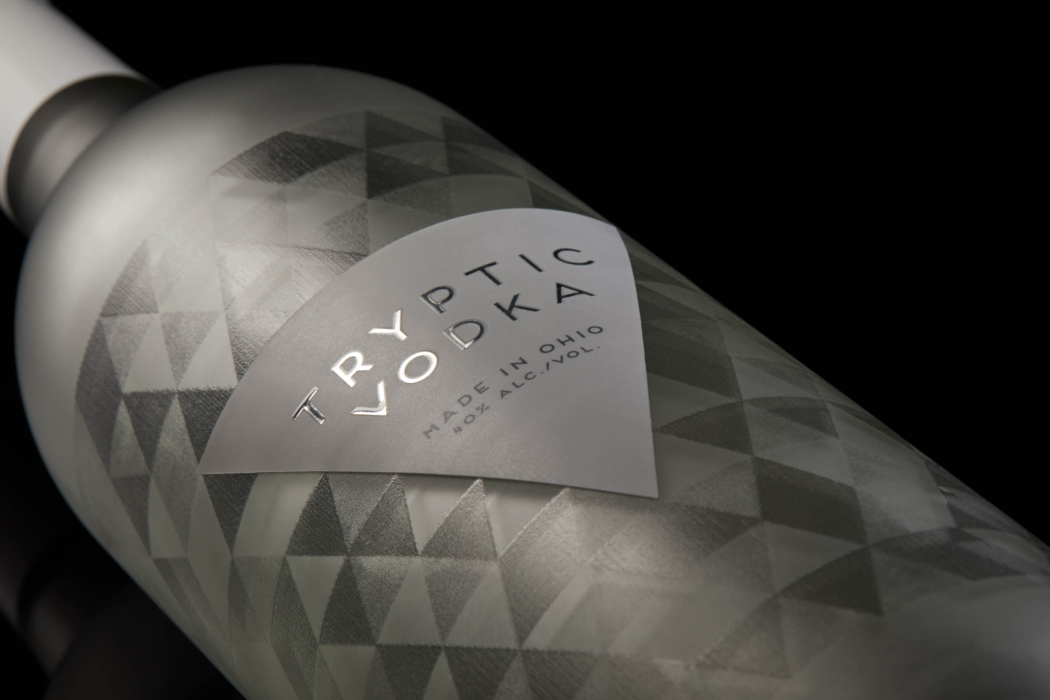 Drink photography of Tryptic Vodka bottle and label - close angle view - dark mode photo