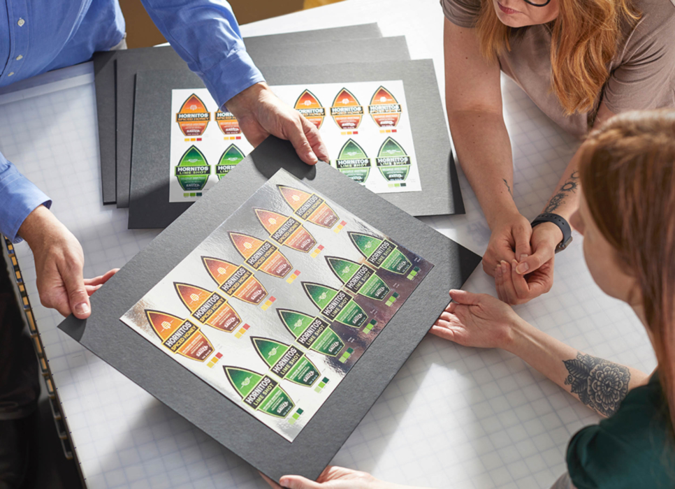 Workplace photography of a team working on product labels and printing