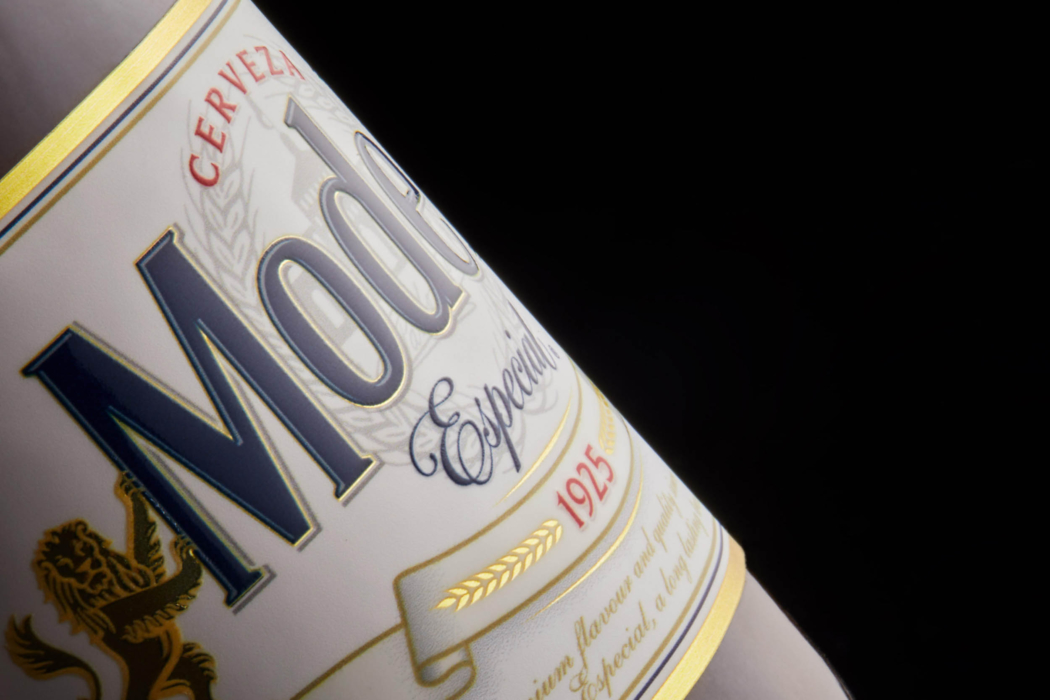 Drink photo of Modelo beer bottle and label close up view - dark mode photo