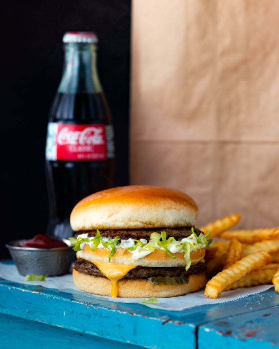 Food photo of a classic big boy burger with fries and a coke for a restaurant menu.