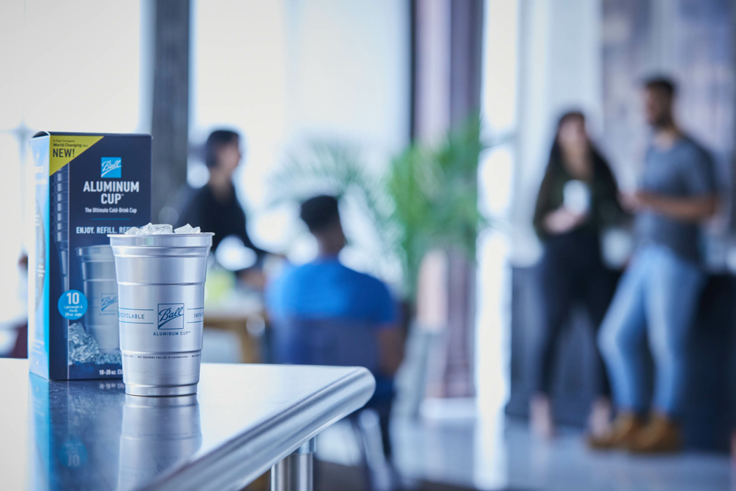 lifestyle -drink-photography-ball - aluminum cup -group in background