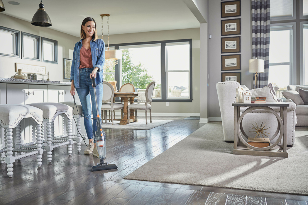 Product Photography, stick vacuum, woman at home